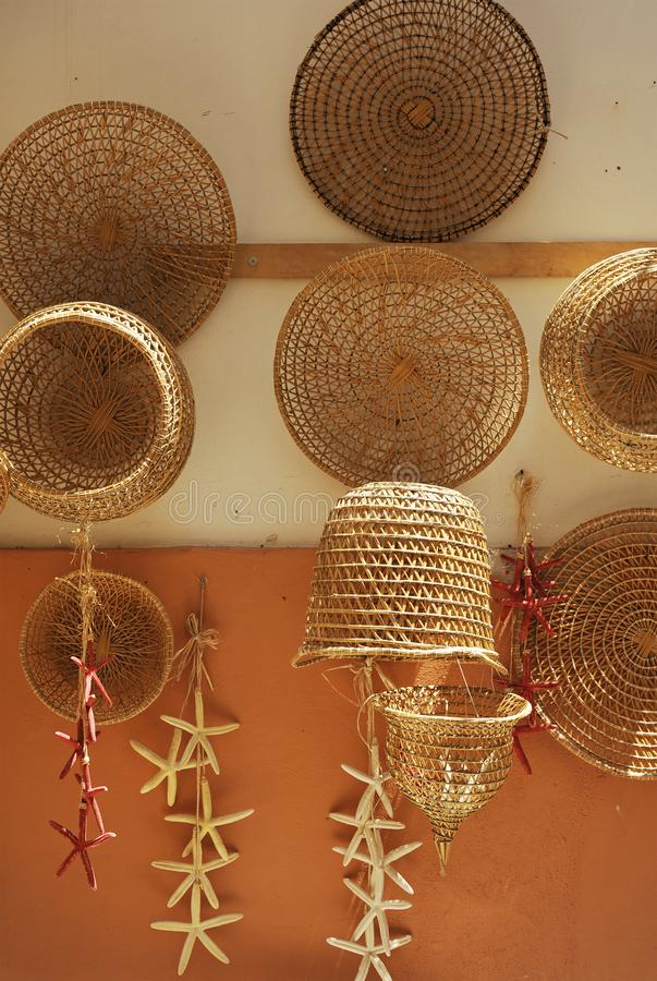 Old fishing nets and baskets made of straw and handmade. Gallipoli, Apulia, Italy royalty free stock photos