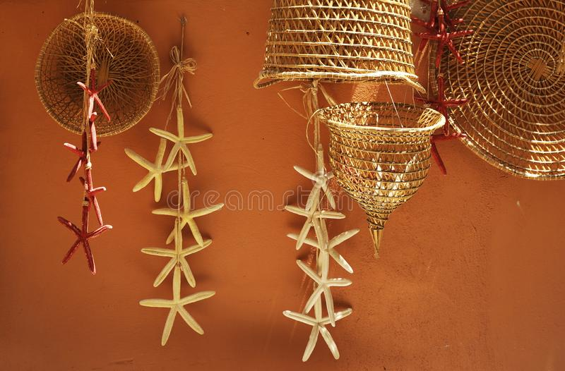 Old fishing nets and baskets made of straw and handmade. Gallipoli, Apulia, Italy stock photos