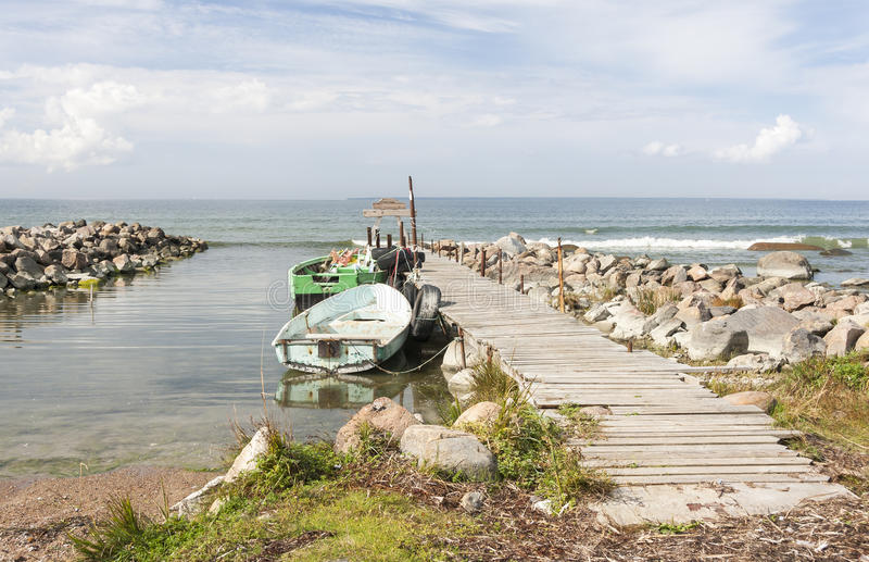 Download Old Fishing Oar Boats In Sea Attached To Bridge Stock Image - Image of boat, landscape: 33328061