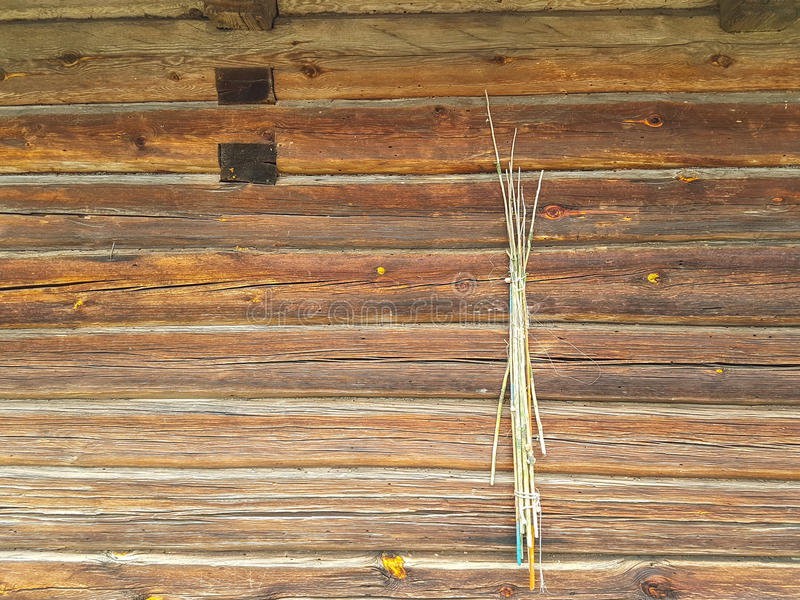 Old fishing rods. Hanging on a wooden wall, horizontal stock photography