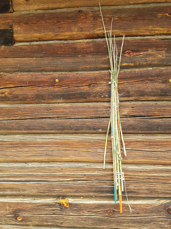 Old fishing rods. Hanging on a wooden wall, vertical stock photography