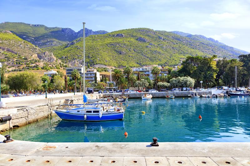 View of the pier of the bay, where old fishing schooners, boats and boats are moored in the clear waters of the Ionian Sea stock photos