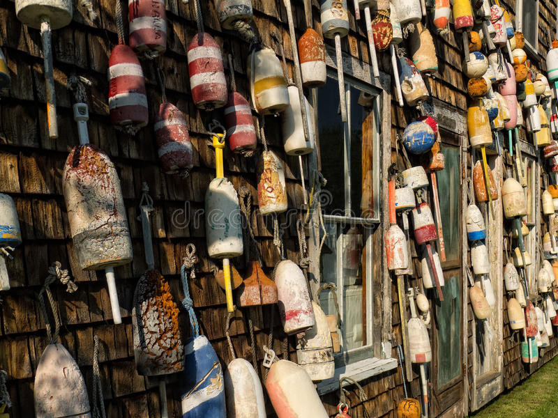A old fishing shack covered in lobster trap floats. An old fishing and lobster shack completely covered with old found lobster trap floats in various colors and royalty free stock photography