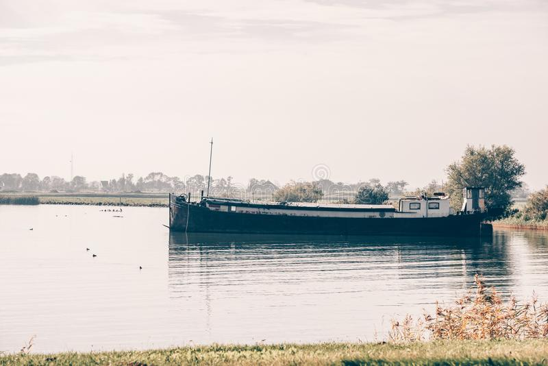 Old ship in a harbor of a dutch village royalty free stock photography