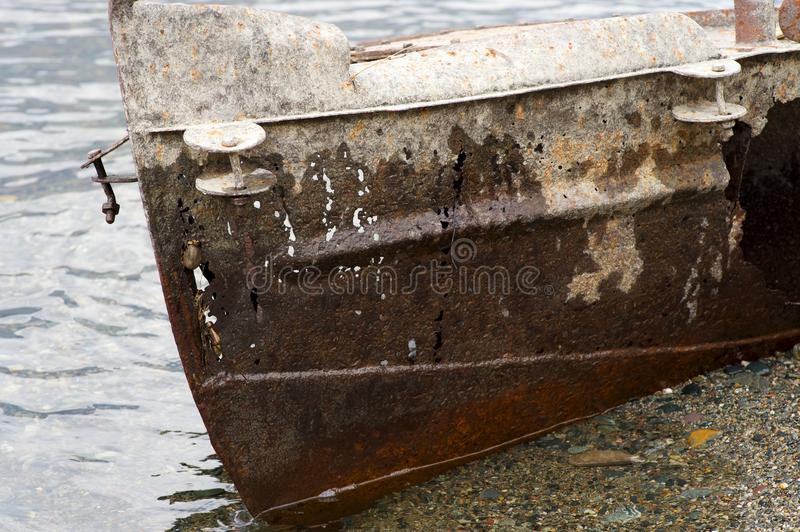 Old fishing vessel on the lake coast stock images