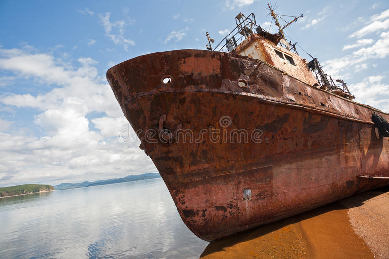 Old fishing vessel on the sea shore royalty free stock photo