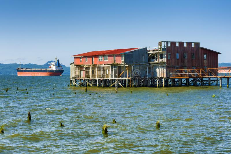Old Fishnet drying building And Freighter royalty free stock images