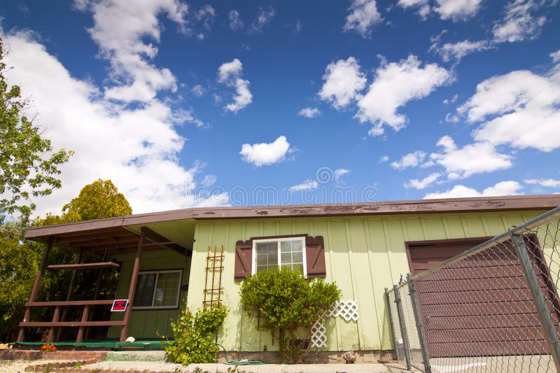 Old Fixer Upper House. Older Fixer Upper House with blue sky and clouds royalty free stock photos