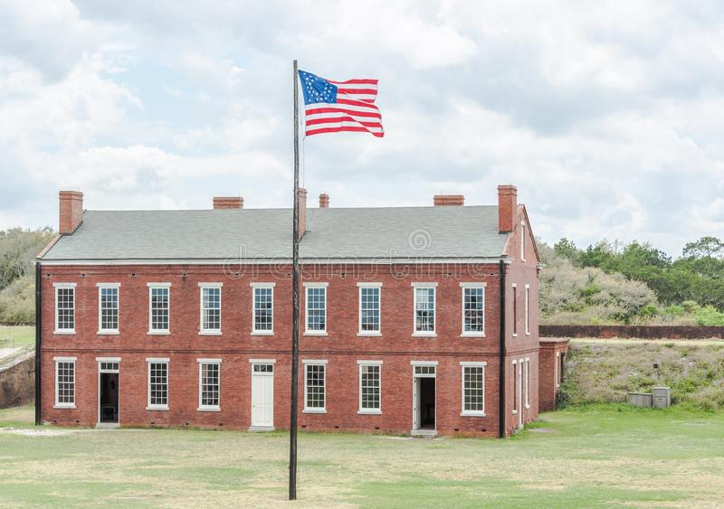 Old Flag. Building on a fort flying the flag of it's time from the civil war age royalty free stock photo