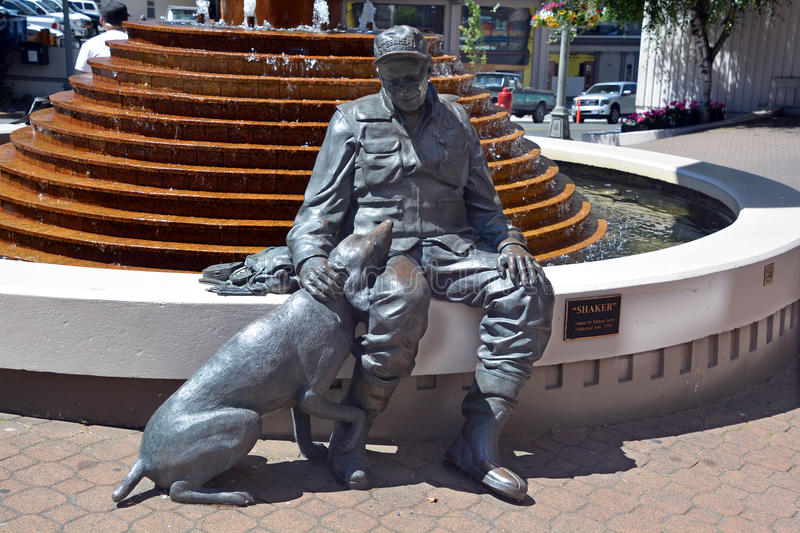 Old flyfisherman and his dog. VICTORIA BC CANADA JUNE 23 2015: A sculpture of an old flyfisherman and his trusty companion-his dog Shaker by Nathan Scott stock photo