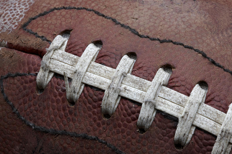 Old Football. Close-up shot of old roughed up football fills frame royalty free stock photos