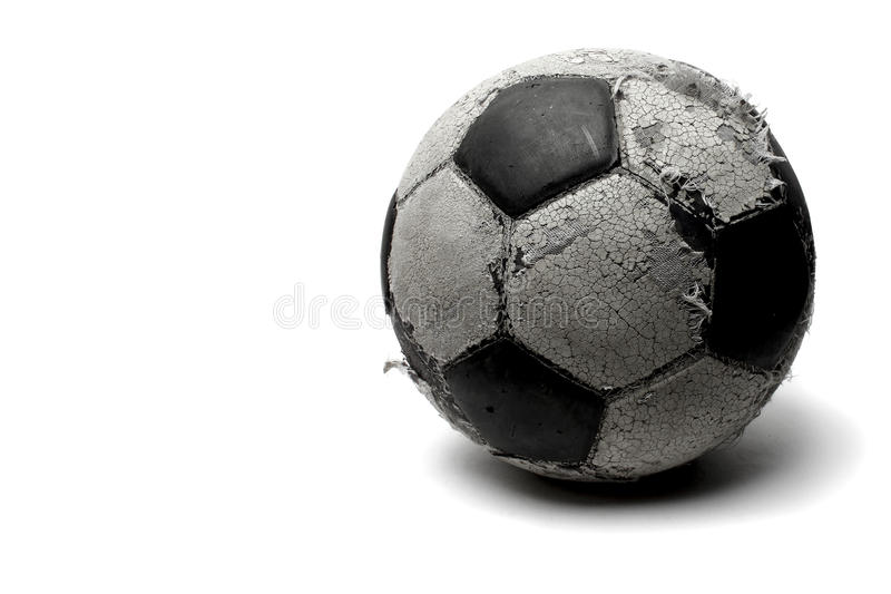 Old football. Isolated on white stock photography