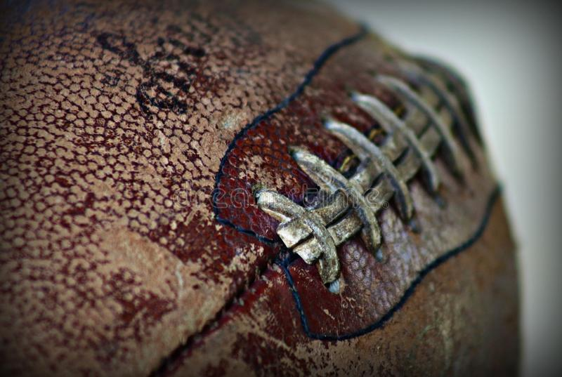 An old Football. A closeup of an old football stock photography