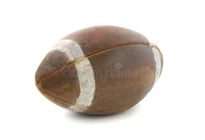 Old football. View of an old regulation size football against a white background stock image