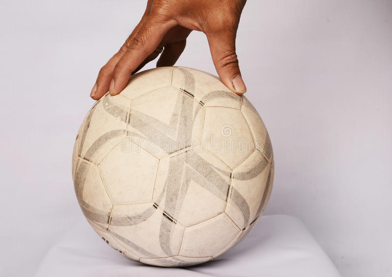 Old football classic. Antique picture about Sports Football is in the studio. Background white by hand motion capture action and old stains show traces of soccer stock image