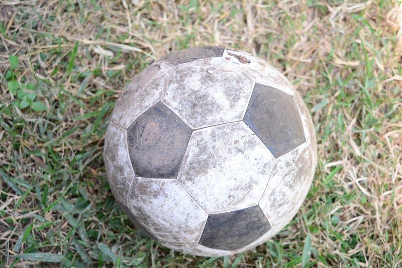 Old football on ground stock photo