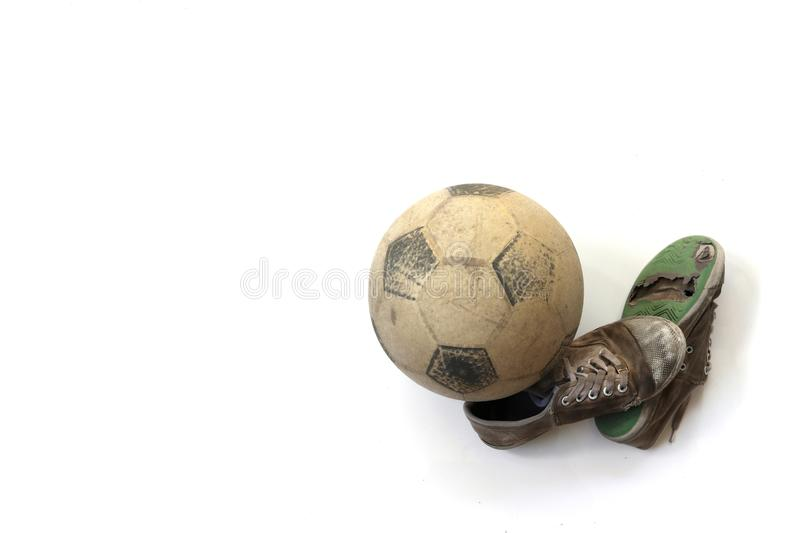 Old football and old shoes isolated on white background royalty free stock image