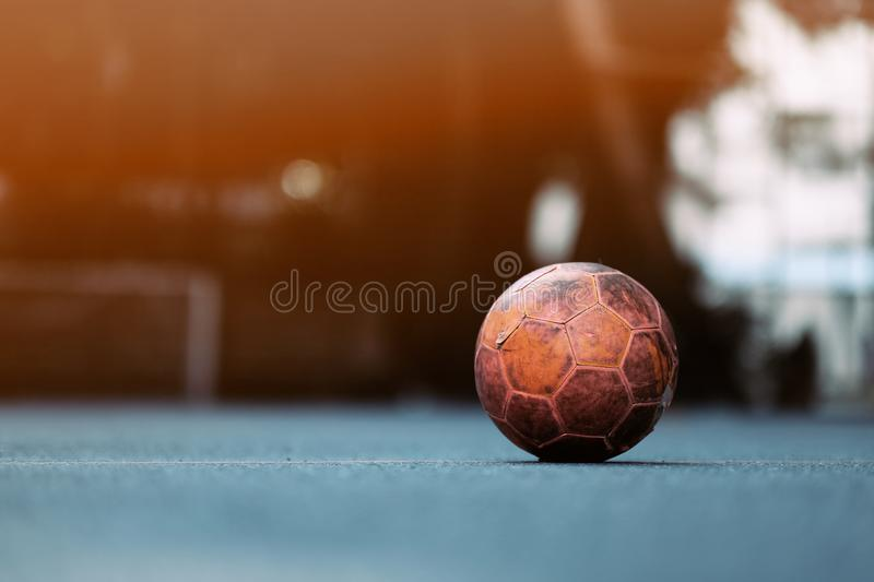 The old football on the street in Bangkok city. Soccer, sport, urban, outdoor, game, background, goal, play, concrete, green, competition, center, field royalty free stock image