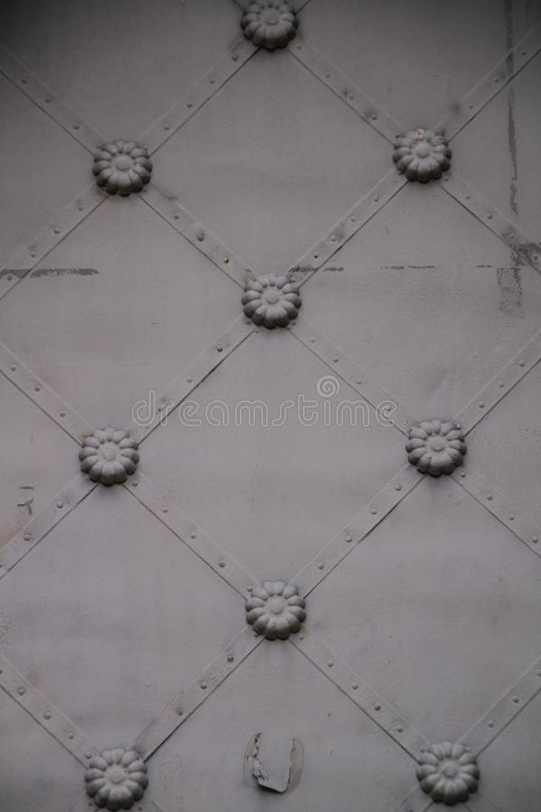 Old forged metal door. In Santa María Magdalena Sanctuary in Novelda, Alicante, Spain royalty free stock images
