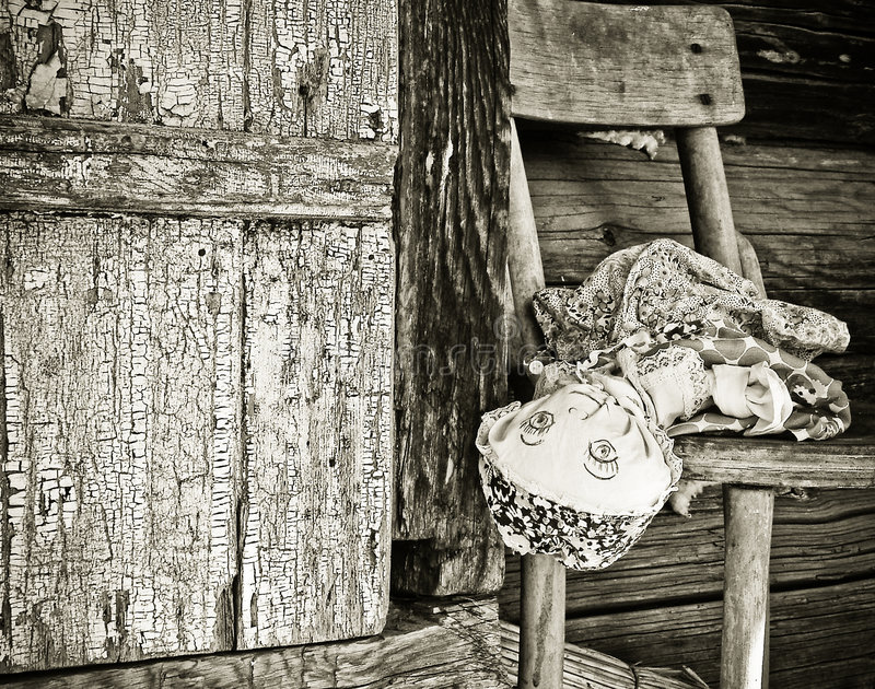 Old Forgotten Doll stock photography