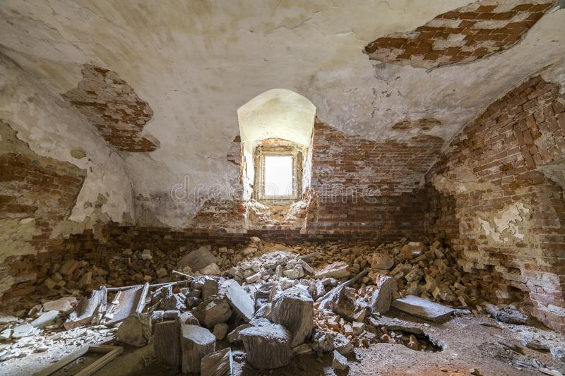 Old forsaken empty basement room of ancient building or palace with cracked plastered brick walls, low arched ceiling, small stock images