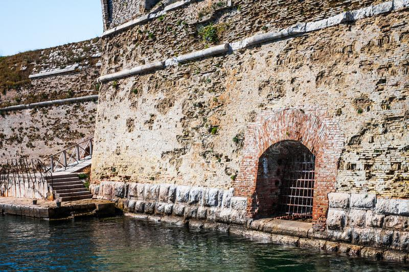 Old fort on the sea shore. Window with bars stock image
