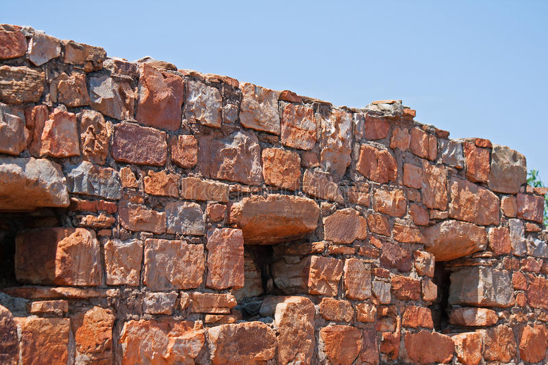 OLD FORT WALL WITH WITH WINDOW OPENINGS. Openings in wall of old fort ruins royalty free stock photos
