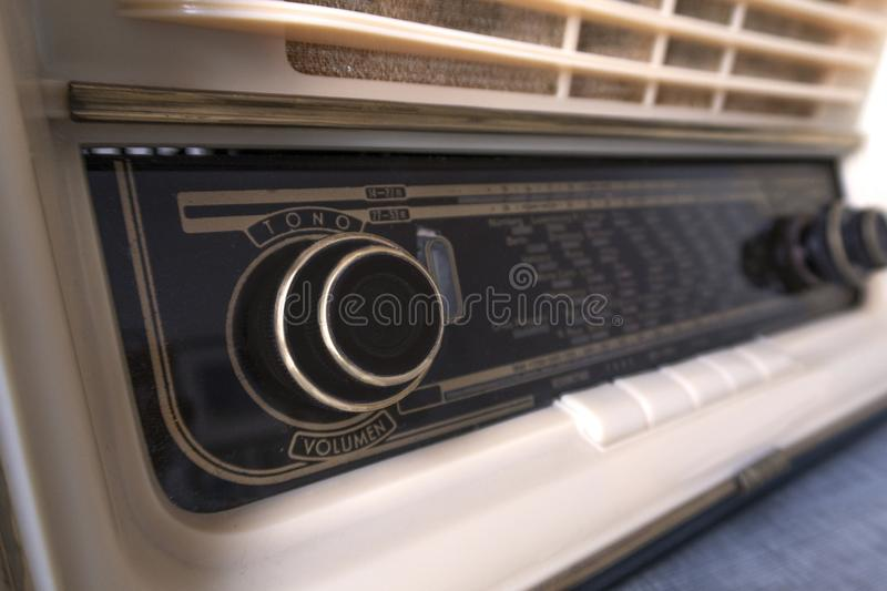 Vintage old radio Forties, on white background. Old forties radio, old dial with different wave frequencies stock photo