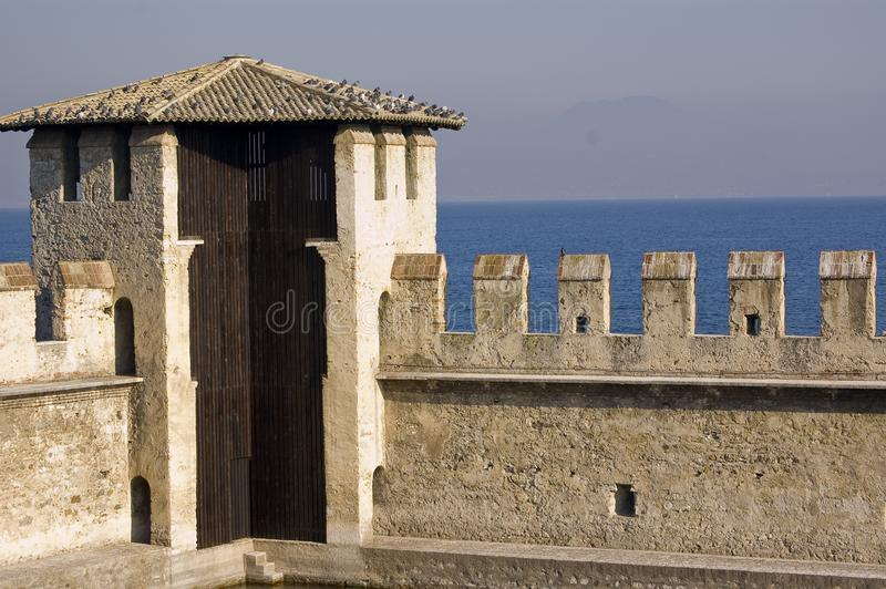 The fortification on the Garda`s lake, Lazise, Italy. The old fortification located on the Garda`s lake in Lazise, Italy stock images
