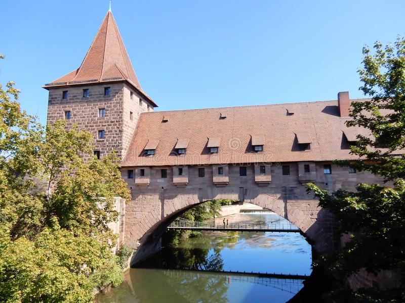 Old fortifications of Nuremberg with tower, water gate, Germany. Nuremberg - ancient monumental fortress wall with tower, water gate, Nürnberg - German state stock photos