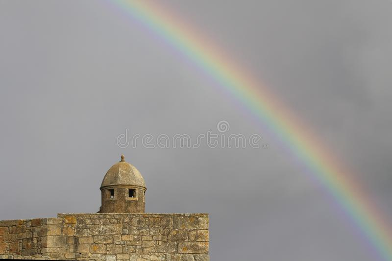 Old fortress wit rainbow royalty free stock photo
