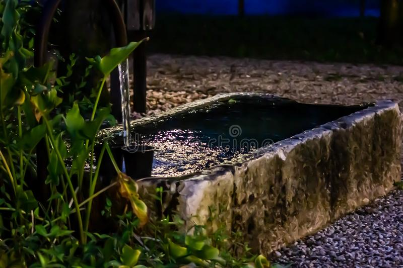 Old fountain, at the base a stone basin that contains the water once to feed the cattle.  royalty free stock photos