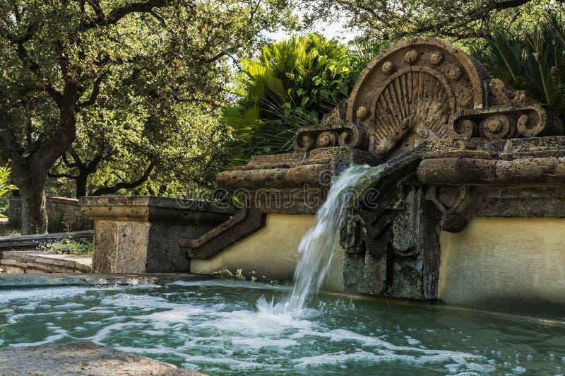 Old fountain at botanical garden. Fountain in the center of the San Antonio botanical gardens royalty free stock image