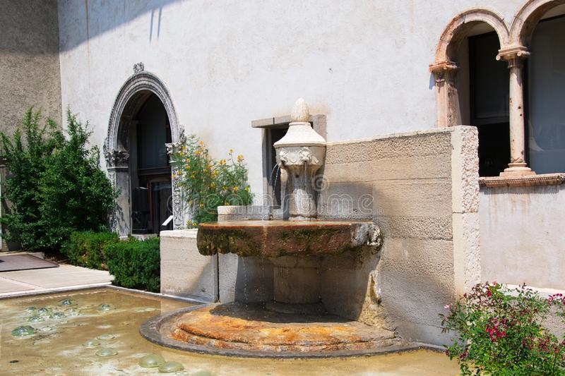 Old fountain in the courtyard stock photos
