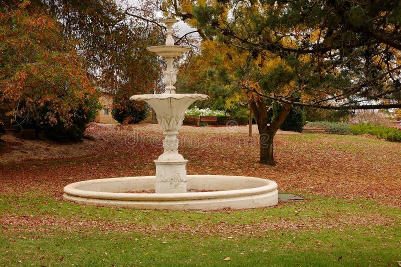 Fountain and Autumn leaves in a Park at Ararat Victoria Australia stock photo