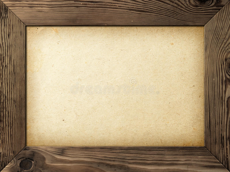 Old Frame. Old wood frame with yellowed paper inside stock photo