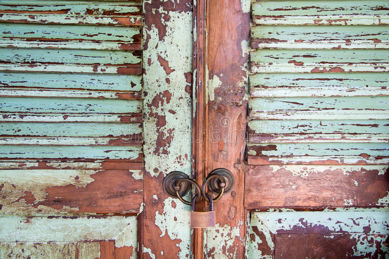 Old frayed doors. Frayed old doors with lock stock photo