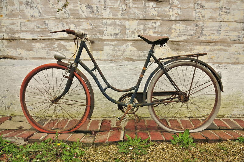Old French Bicycle. Vintage French Bicycle against a Wooden Wall royalty free stock photography