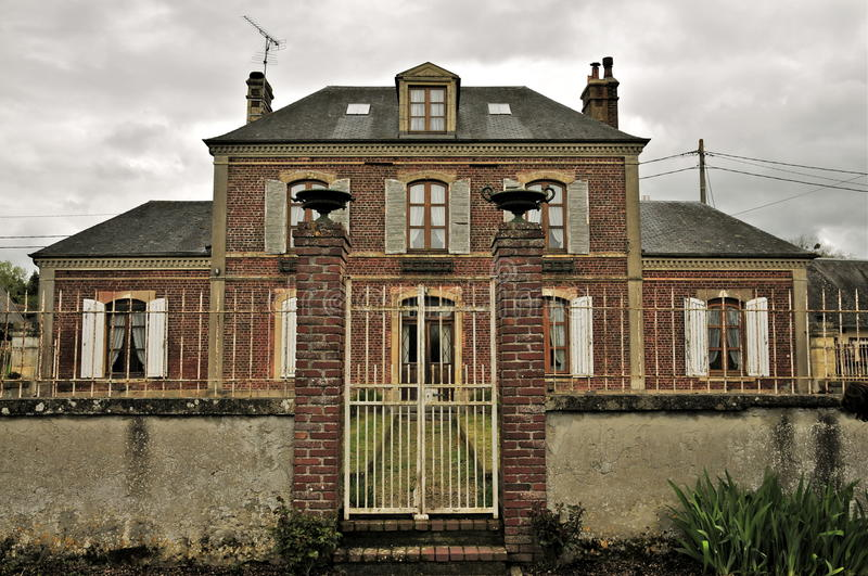 Old French Farmhouse. Dairy Farm in Normandy, France- known for its Camembert, with overcast stock photos