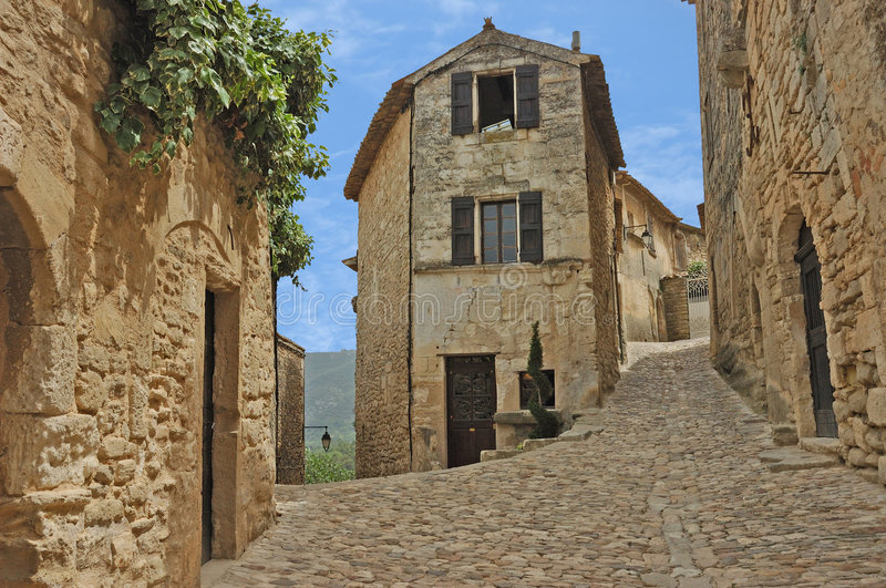 Old French Village. Old French cobblestone street in the village of Lacoste in the French Provence royalty free stock photography