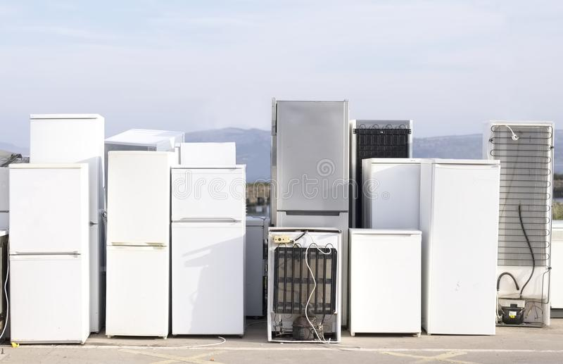 Old fridges freezers refrigerant at refuse dump skip recycle plant help environment. Save the planet royalty free stock photography