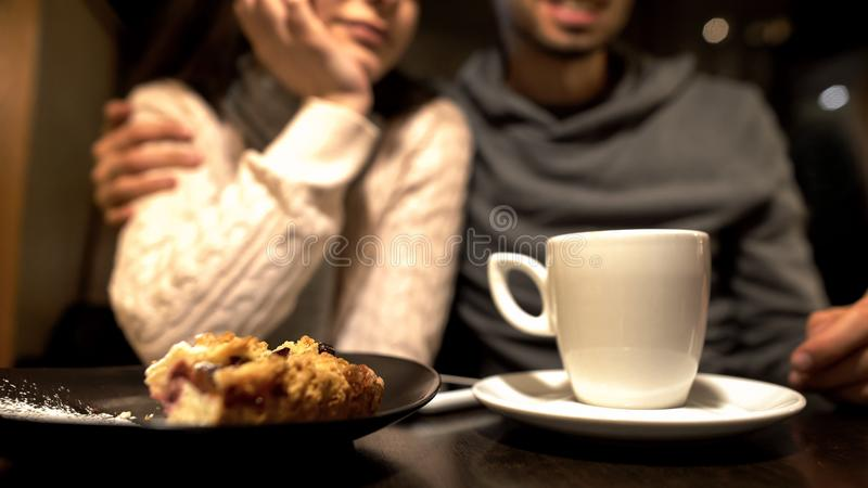Old friends sitting in cafe, hugging and talking, warm relationship, close up stock photography