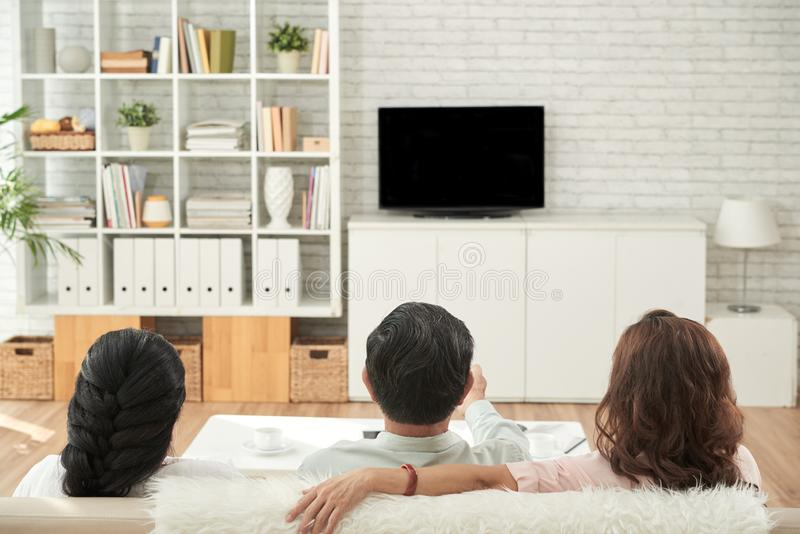 Old friends watching tv royalty free stock photos