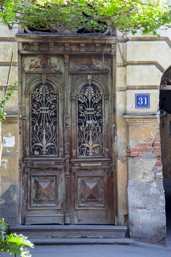 The old front door of an apartment building. Vertically stock photo
