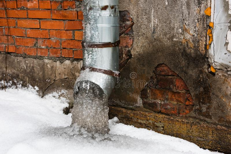 An old frozen pipe of an abandoned building royalty free stock photography