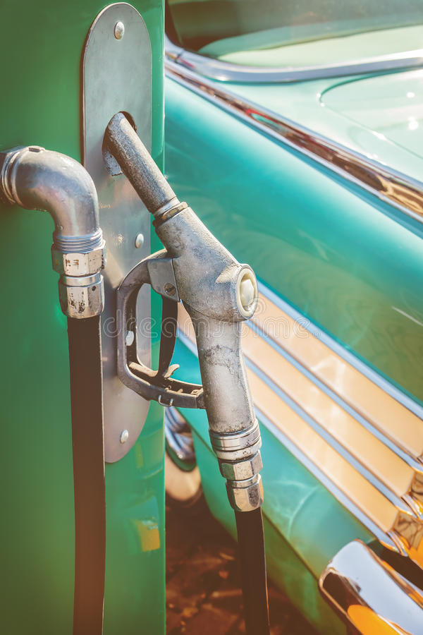 Old fuel pump in front of a classic car stock photos