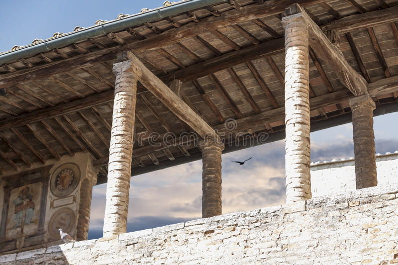 Old gallery. Ancient building detail with pillars in Italy royalty free stock image