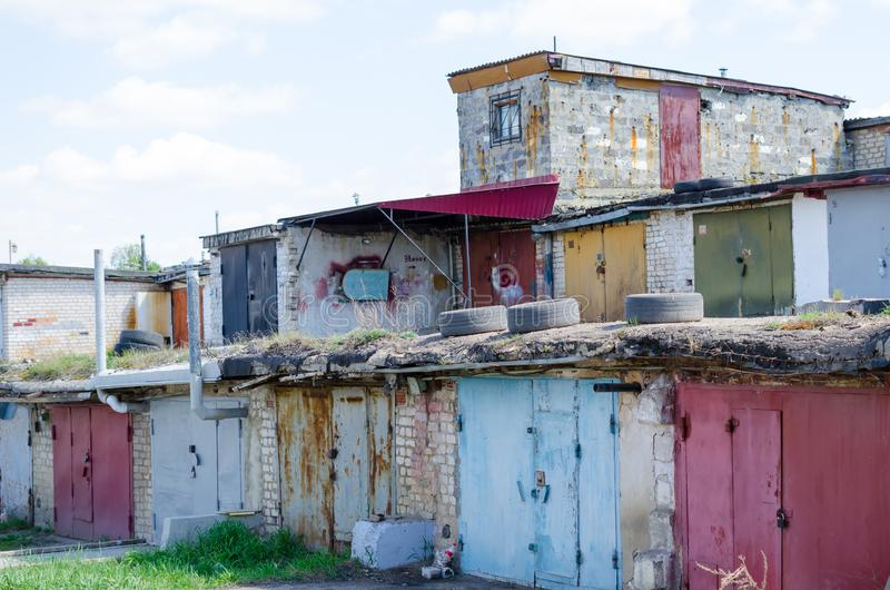 Old garages with closed rusty doors stacked on top of each other stock image