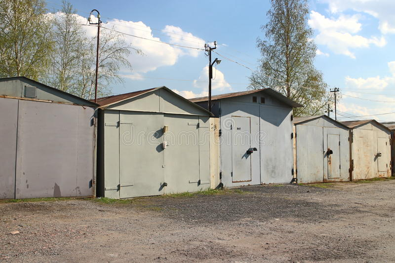 Old garages in a row. Old private garages for passenger cars royalty free stock photography