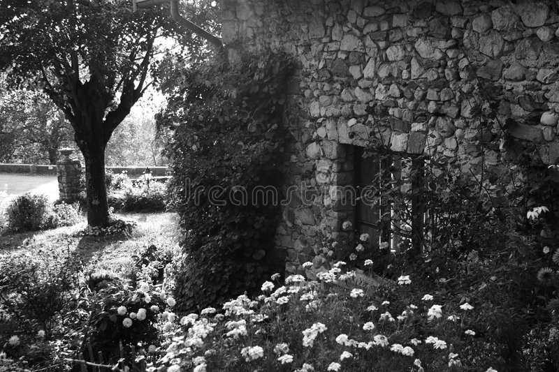 Old garden and house stock photo